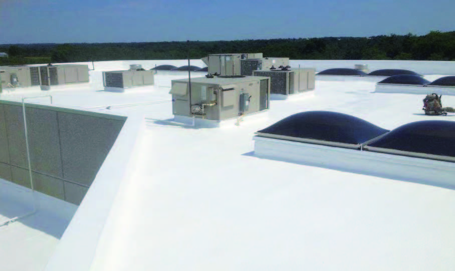 A completed white roof using our fabric reinforced roofing system.