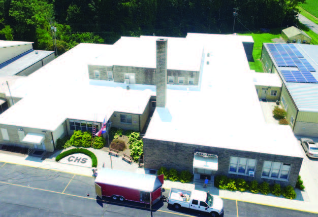 Sky view of a completed white roof restoration project.