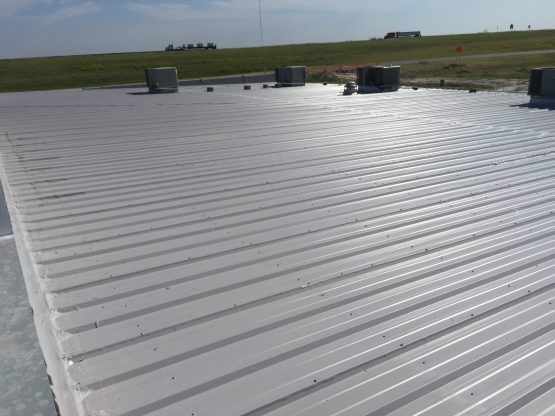 A completed metal commercial roofing project.
