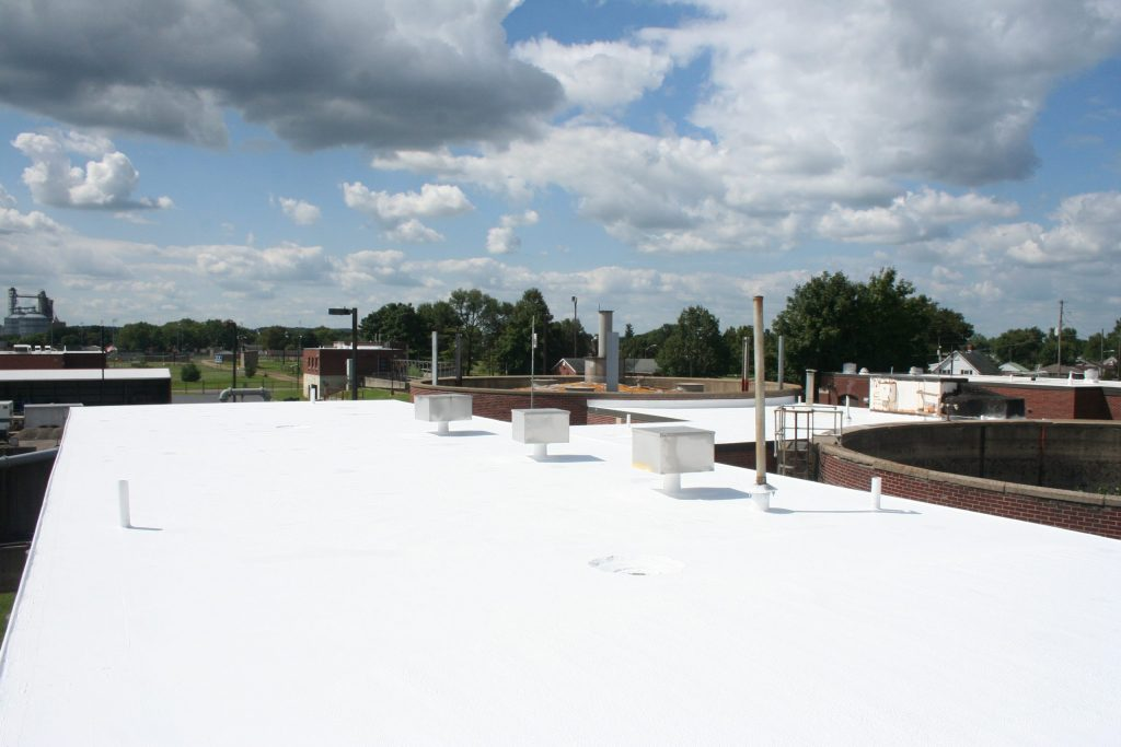A completed white membrane roof restoration project.